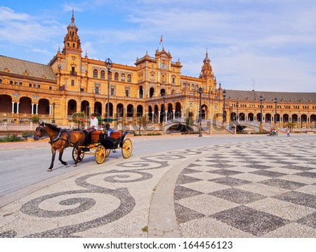 SEVILLE , SPAIN - JUNE 4: Unidentidied people in the carriage on Plaza de Espana located in the Parque de Maria Luisa on June 4, 2013 in Seville, Spain. It is one of the biggest squares in Spain. - stock photo