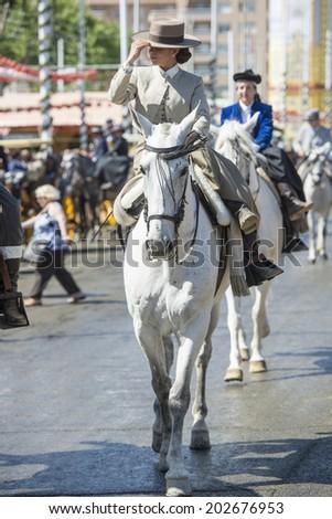 SEVILLE, SPAIN-MAY 8: Amazon mounted on horse on fair of Seville  on May 8, 2014 in Seville. - stock photo