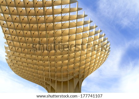 SEVILLE, SPAIN-MAY 09 2013: Metropol Parasol in Plaza de la Encarnacion. This wooden structure designed by J. Mayer-Hermann is made from bonded timber with a polyurethane coating. - stock photo