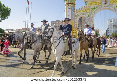 SEVILLE, SPAIN-MAY 8: People mounted on horse on fair of Seville on May 8, 2014 in Seville - stock photo