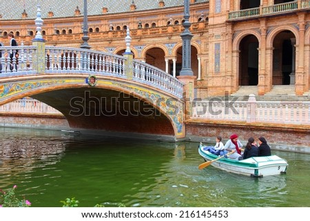 SEVILLE, SPAIN - NOVEMBER 3, 2012: People visit Plaza de Espana in Seville, Spain. Seville is a major tourism destination in Spain with 4.8 million hotel-nights in 2011. - stock photo