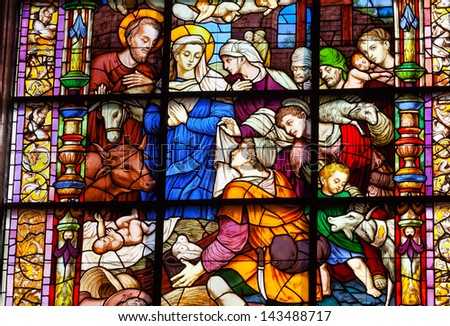 SEVILLE, SPAIN--OCTOBER 20: Nativity Mary Joseph Stained Glass Created 1500s in Seville Cathedral, Cathedral of Saint Mary of the See, Seville, Andalusia Spain on October 20, 2012.  Built 1500s. - stock photo