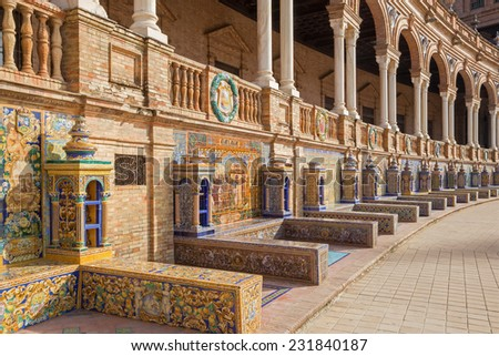 SEVILLE, SPAIN - OCTOBER 27, 2014: Plaza de Espana square designed by Ani�­bal Gonzalez (1920s) in Art Deco and Neo-Mudejar style and tiled 'Province Alcoves' along walls realized by Domingo Prida.  - stock photo