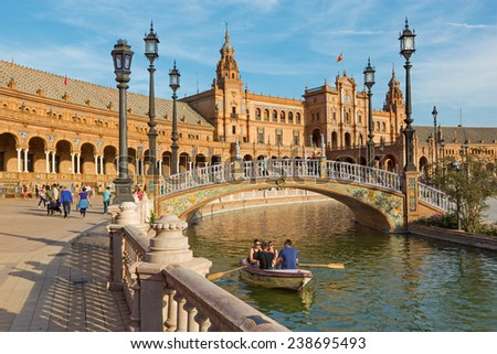 SEVILLE, SPAIN - OCTOBER 27, 2014: Plaza de Espana square designed by Anibal Gonzalez (1920s) in Art Deco and Neo-Mudejar style.  - stock photo