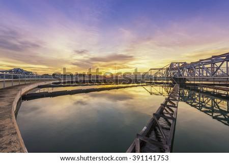 sewage treatment plant with sunrise - stock photo