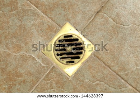 sewer grate drain water - stock photo