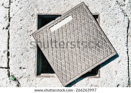 sewer in a street - stock photo