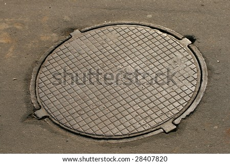 Sewer manhole cover - stock photo