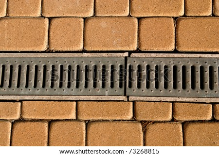 Sewerage system on the footpath in the city. - stock photo