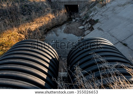 sewers, drains out into the river - stock photo