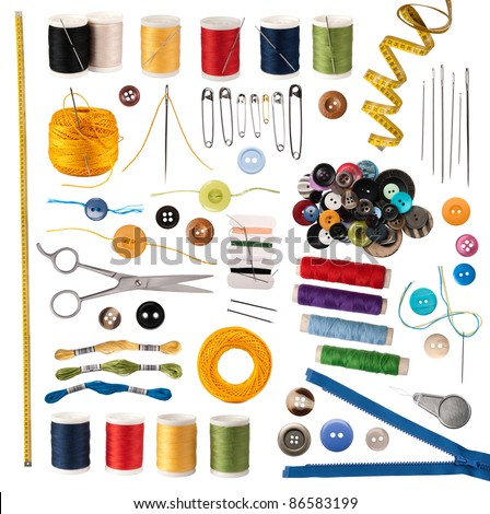 Sewing accessories isolated on white - stock photo