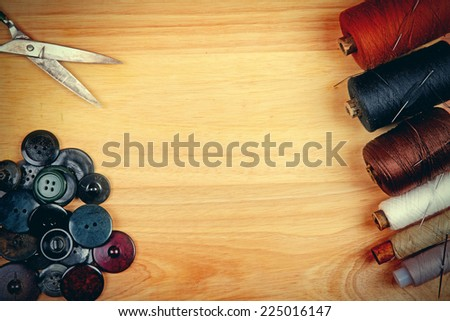 Sewing Accessories on the Table Closeup - stock photo