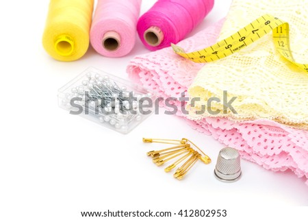 Sewing accessories on white - stock photo