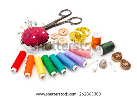 Sewing accessories: scissors, measuring tape, thimbles, colorful threads and buttons - stock photo