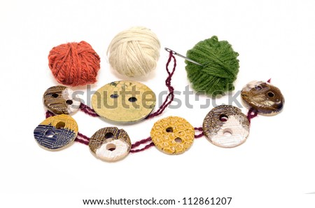 Sewing elements: button, needle, clew - stock photo