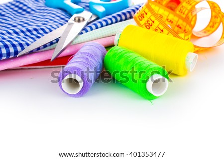 Sewing kit. Accessories for needlework on a light background. Spool of thread, scissors, buttons, measuring tape, sewing accessories. Set for needlework top view - stock photo