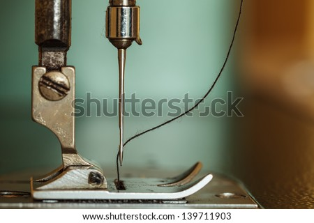 Sewing machine and thread rolling. - stock photo
