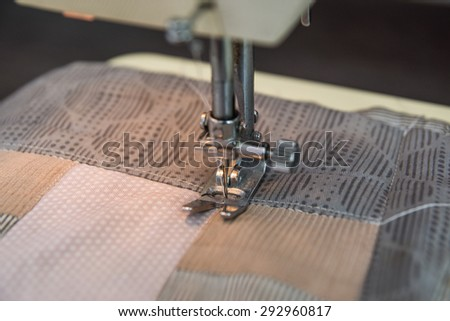 Sewing machine mechanism closeup with metal details. Sewing cotton patches for patchwork - stock photo