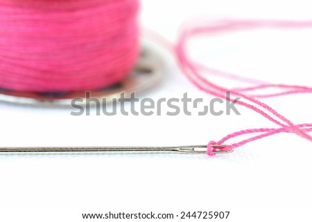 Sewing needle and Yarn on a white background , Focused on Hole needle - stock photo