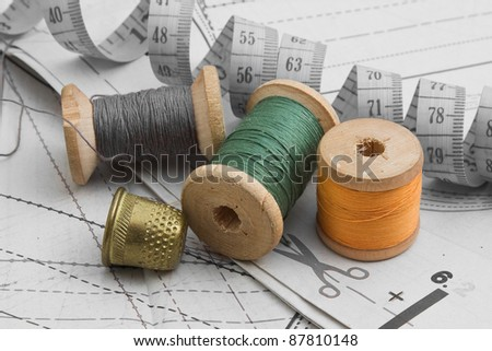 Sewing on the background pattern - stock photo