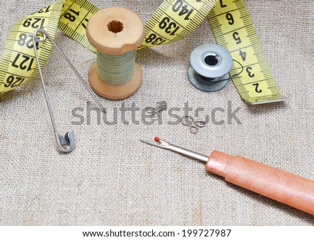 Sewing still life of wooden spool - stock photo