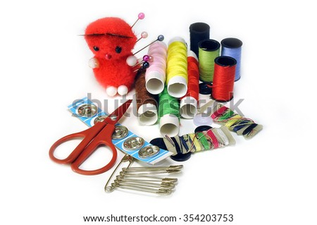 Sewing Supplies on a white background - stock photo