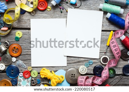 Sewing Supplies on Wood Background - stock photo