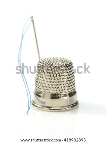 sewing thimble isolated on white background - stock photo