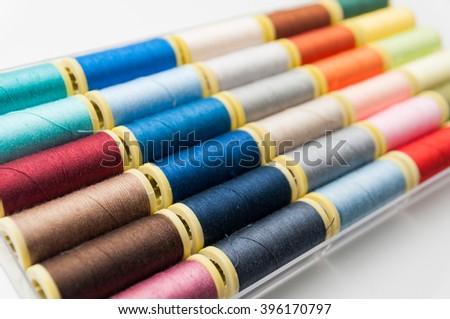 Sewing thread /  colourful thread - stock photo