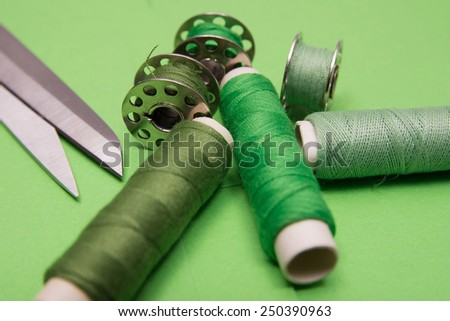Sewing thread in different shades of green - stock photo