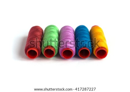 sewing threads of different colors - stock photo