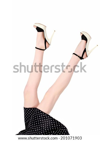 Sexiness falling from the sky. Hot girl with mini skirt and sexy long legs in high heels. Isolated on white. - stock photo