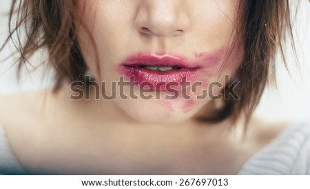 Sexual  beautiful lips with the smeared lipstick - stock photo