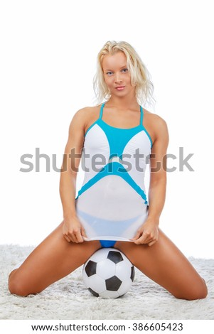 Sexual blond woman posing with football. - stock photo
