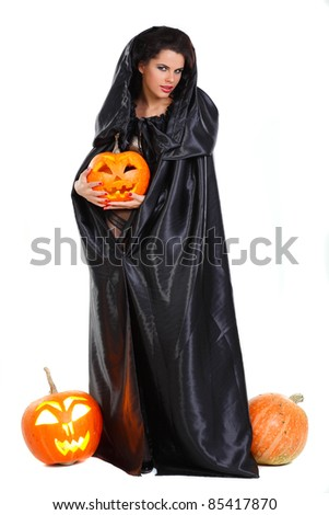Sexual brunette in the suit of witch in night of Halloween - stock photo