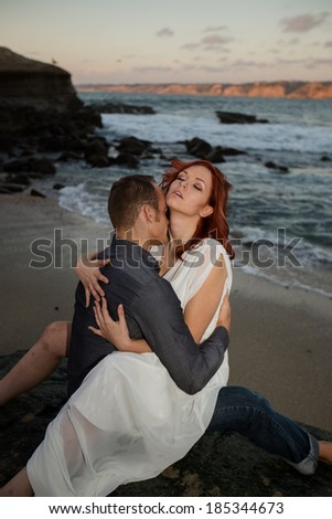 Sexual Couple at Beach - stock photo