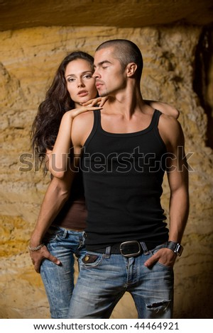 Sexual couple in cave - stock photo