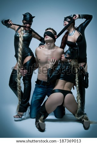 Sexual games of young women and man - stock photo