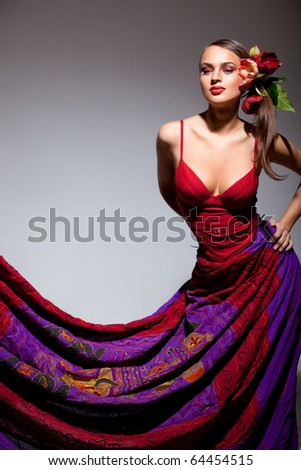 Sexual girl in red dress with flowers in her hair - stock photo
