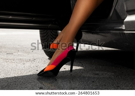 Sexual woman's legs in cute high heels outdoors - stock photo