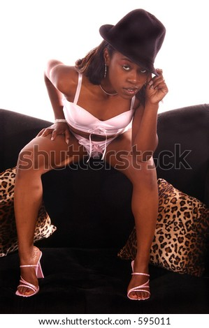 Sexy African American woman in pink lingerie and a black gangster hat - stock photo