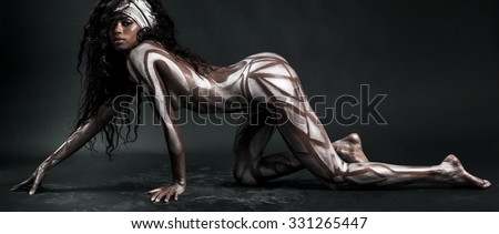 Sexy african model body painted with polygons letterbox - stock photo