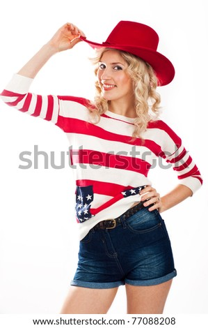 Sexy american-dressed girl in red hat - stock photo