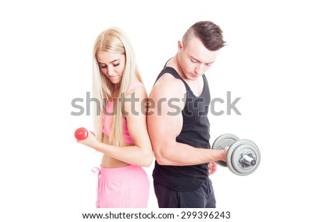 Sexy and attractive fitness couple holding weights isolated on white - stock photo