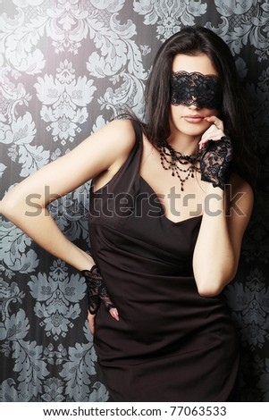 sexy and beautiful woman with a black lace on her eyes - stock photo