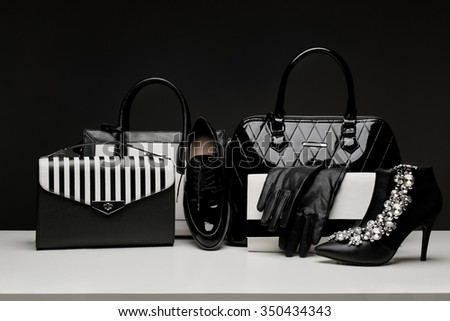 Sexy and fashionable set of glamour black and white accessories for woman - stock photo