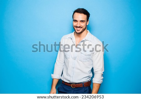 sexy and handsome man with beard on a blue background - stock photo