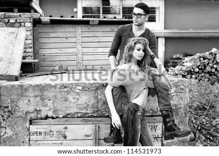 Sexy and stylish young couple wearing jeans (Photo has an intentional film grain) - stock photo