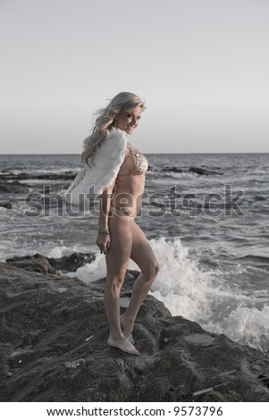 Sexy Angel in Black and White with light color - stock photo