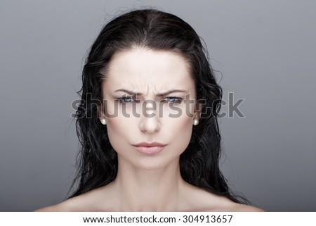 Sexy annoyed young brunette woman portrait - stock photo